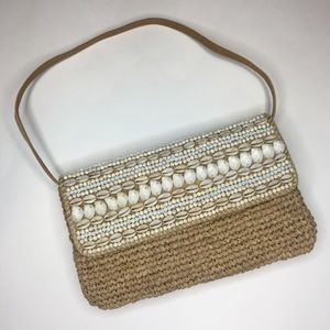 Tommy Bahama Woven Clutch adorned with Shells